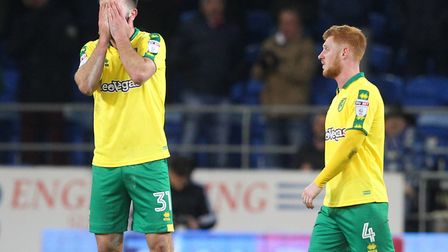 It's agony for Grant Hanley as Norwich City slip to Championship defeat at Cardiff. Picture: Paul Ch