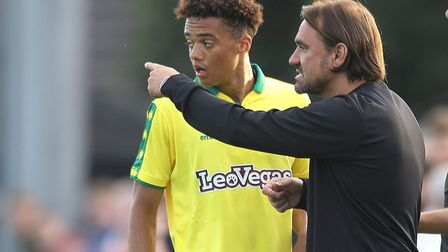 Jamal Lewis takes instructions from Norwich City head coach Daniel Farke during pre-season. But for