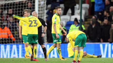 James Maddison is shown a yellow card from referee Andy Davies for protesting too much after Cardiff