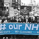 Demonstrators attend a rally in support of the NHS