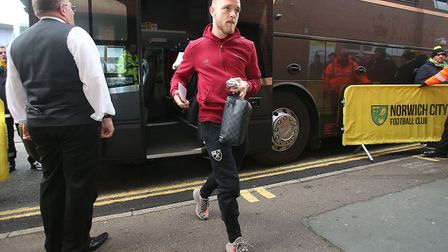 Alex Pritchard gets off the Norwich City team coach, before going on to make his Canaries comeback a