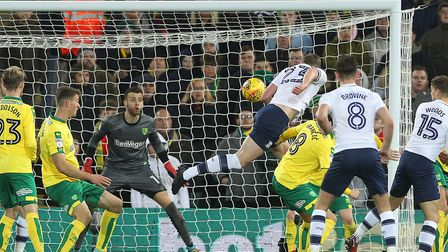 Paul Huntington of Preston North End heads for goal but Tom Barkhuizen turns it into the net and sco