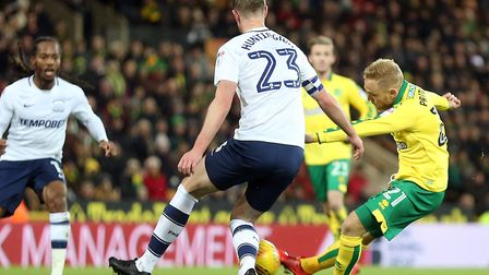 Alex Pritchard pulls the trigger on his Norwich City comeback against Preston, watched in the backgr