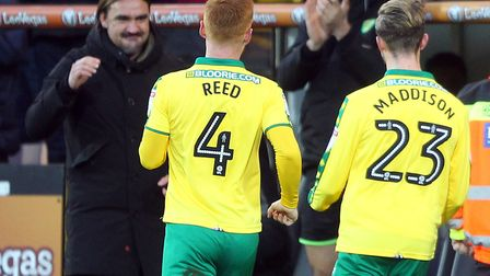 James Maddison heads for Norwich City head coach Daniel Farke, after opening the scoring against Pre