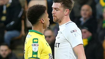 Josh Murphy and Paul Huntington have a difference of opinion during Norwich City's 1-1 draw with Pre