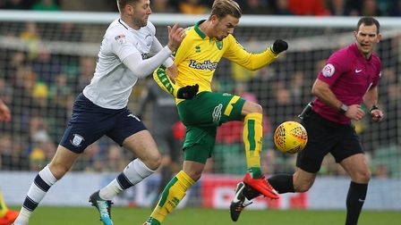 James Maddison tries to break free of Paul Gallagher during Norwich City's 1-1 draw with Preston Nor