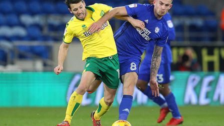 Wes Hoolahan of Norwich and Joe Ralls of Cardiff City in action during the Sky Bet Championship matc