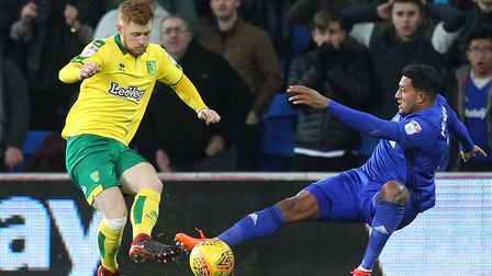 Harrison Reed gets rid of the ball as Nathaniel Mendez-Laing presses, during Norwich City's 3-1 defe