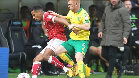 Harrison Reed battles with Bristol City midfielder - and Canaries academy product - Korey Smith, whi