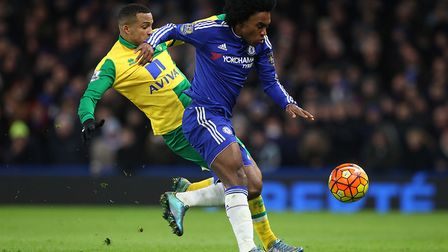 Willian is challenged by Martin Olsson during the Premier League game at Stamford Bridge in Novembe