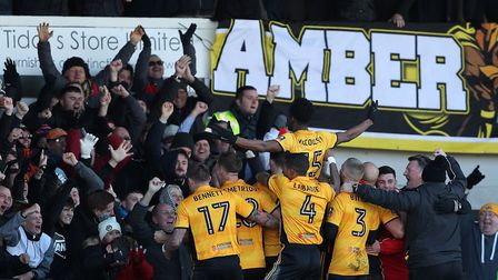 Newport County's Shawn McCoulsky, centre, celebrates scoring his side's second goal against Arsenal.