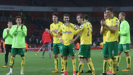 City's players salute the hordes of travelling fans following their League Cup defeat at Arsenal. Pi