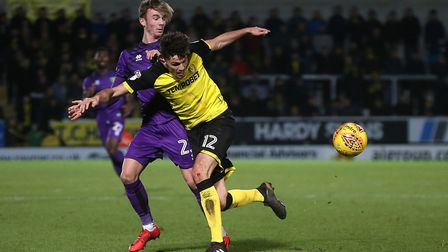 James Maddison and Tom Flanagan in close-quarters action at Burton. Picture: Paul Chesterton/Focus I