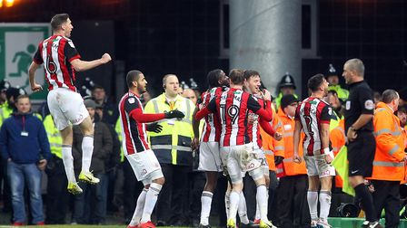 Sheffield United celebrate their second goal at Carrow Road on a disappointing afternoon for the Can
