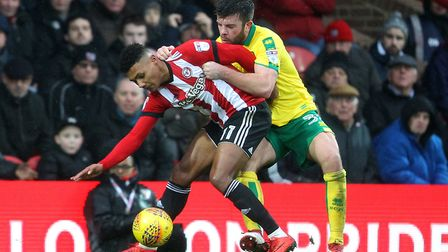They shall not pass - Grant Hanley gets to grips with Brentford's Ollie Watkins. Picture: Paul Chest