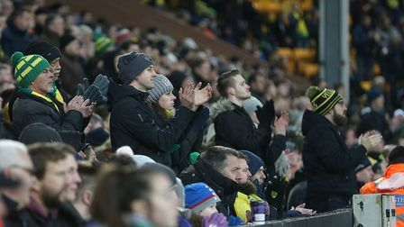 The Norwich City supporters take part in a minute's applause. Picture: Paul Chesterton/Focus Images