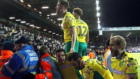 Norwich City's players celebrate their third goal with the traveling fans at Elland Road. Picture: P