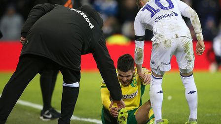 Emi Buendia is helped back to his feet after one of numerous fouls during Norwich City's superb vict