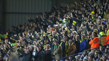 The travelling Norwich fans celebrate City's second goal at Leeds Picture: Paul Chesterton/Focus Ima