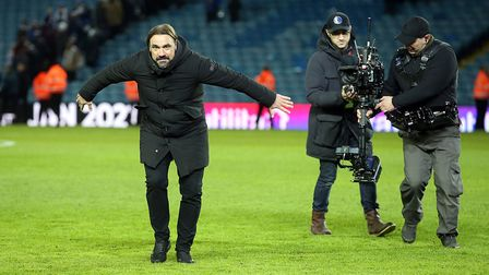 Lights, camera, action ... Daniel Farke celebrates victory at Leeds with the travelling Norwich City