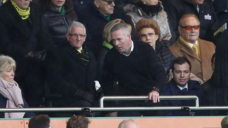 Paul Lambert takes his seat in the directors' box at the start of the second half after being sent o