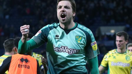 Tim Krul celebrates the important draw at West Brom in January with the 2,700 Norwich City fans who