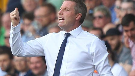 Neil Harris led his newly-promoted Millwall team to a 4-0 thrashing of Norwich City at The Den last