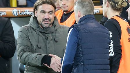 Norwich City head coach Daniel Farke and Millwall manager Neil Harris shake hands at the end of the