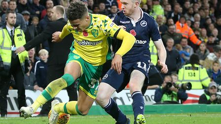 Northern Irish midfielder Shane Ferguson, right, tackling Norwich City's Max Aarons, has been one of