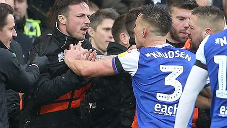 Norwich City goalkeeper coach Ed Wootten was in the thick of the melee as the Canaries fumed at a ba