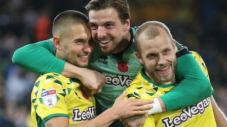 Tim Krul (centre) has been in the thick of a stellar Championship season so far for Norwich City. Pi