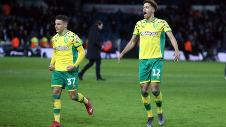 Max Aarons of Norwich and Jamal Lewis of Norwich celebrate victory at the end of the Sky Bet Champio