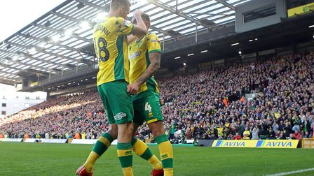 Marco Stiepermann congratulates Ben Godfrey on nabbing Norwich City's second Carrow Road equaliser a