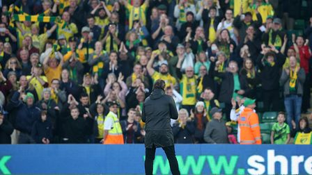 Norwich City head coach Daniel Farke celebrates victory over Bristol City with the home fans at Carr