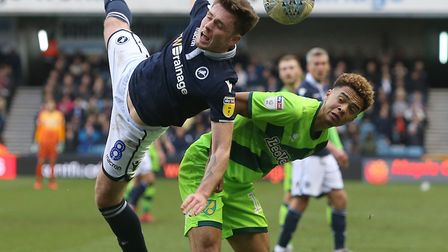 Jamal Lewis stands his ground as Millwall's Ben Thompson prepares for a heavy landing Picture Paul C