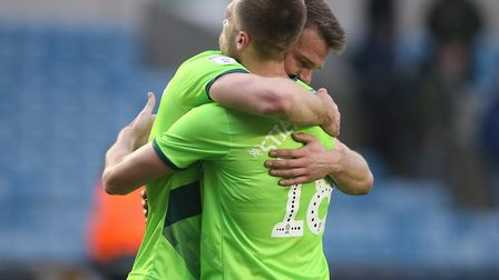 An emotional Christoph Zimmermann embraces Marco Stiepermann following Norwich City's victory over M