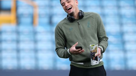 Norwich City centre-back Ben Godfrey was all smiles before kick-off at The Den - as he was after, to