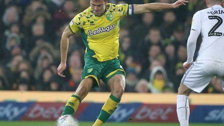 Christoph Zimmermann of Norwich and Matt Grimes of Swansea City in action during the Sky Bet Champio