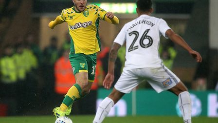 Emi Buendia of Norwich and Kyle Naughton of Swansea City in action during the Sky Bet Championship m