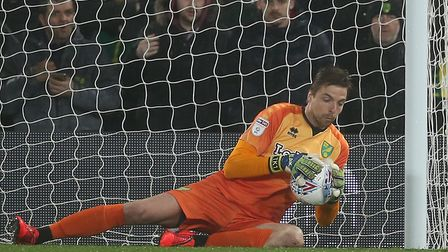 Tim Krul holds on to a shot in the greasy conditions, Norwich City earned victory over Swansea at Ca