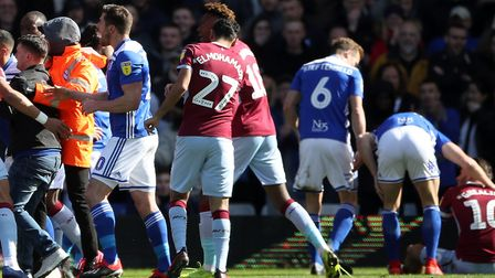 Aston Villa's Jack Grealish was assaulted by a Birmingham City pitch invader in Sunday's 1-0 win for