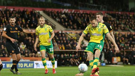 Marco Stiepermann strokes home his opening goal, as Norwich City beat Hull at Carrow Road to return