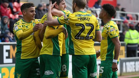 Kenny McLean celebrates with his Norwich City team-mates, scoring their opener and then assisting th