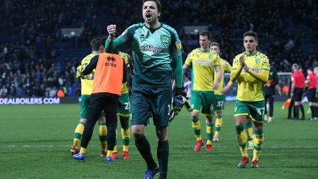 Tim Krul celebrates with travelling Norwich fans after a point at West Brom Picture: Paul Chesterton