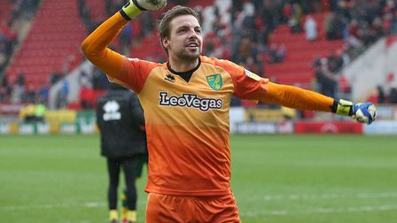 Tim Krul celebrates victory at Rotherham with the 2,600 travelling Norwich City fans Picture: Paul C
