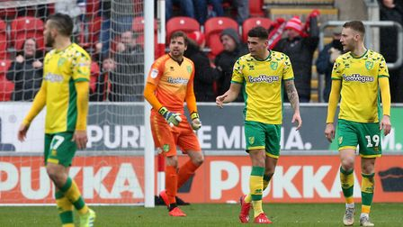 Tim Krul and his Norwich City team-mates gather their thoughts after Rotherham's equaliser at the Ne