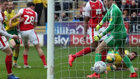 The grounded Ben Godfrey heads Norwich City's winner in a 2-1 victory against Rotherham United Pictu