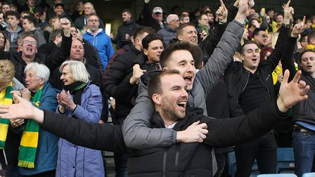 The travelling Norwich City fans celebrate Christoph Zimmermann putting their team 2-1 up at Millwal