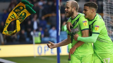 Teemu Pukki, left, and Max Aarons celebrate with more than 3,000 away fans at The Den after the stri