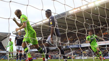 Teemu Pukki and Ben Godfrey (right) celebrate Norwich City's crucial second goal at Millwall, scored